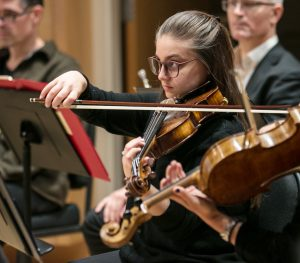 Student playing a violin